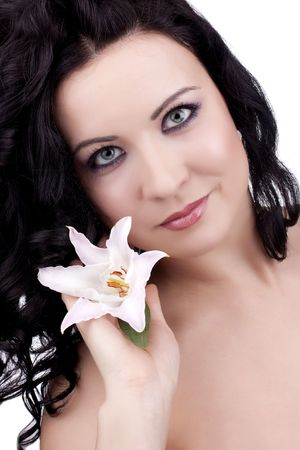 beautiful woman with a lily flower on a white background photo