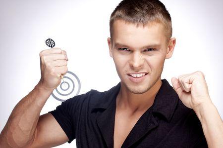 handsome man sends a dart at a target photo