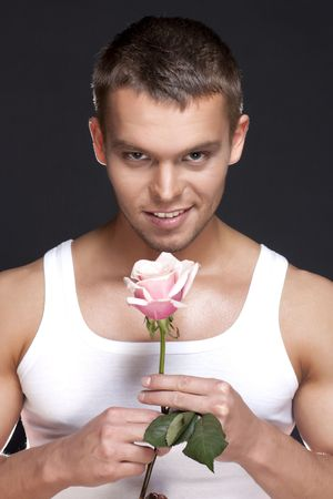 Young handsome men with the pink rose on white background photo