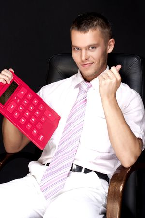 handsome businessman with red calculator photo