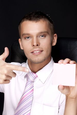 young handsome business man with notes photo