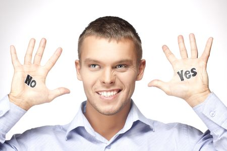 handsome young man offers a choice - yes or no photo