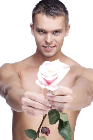 Young handsome men with the pink rose on white background Stock Photo - 6743438