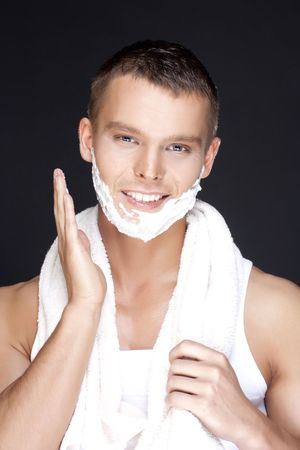 Portrait of  young handsome men shaving on a black background Stock Photo - 6743416