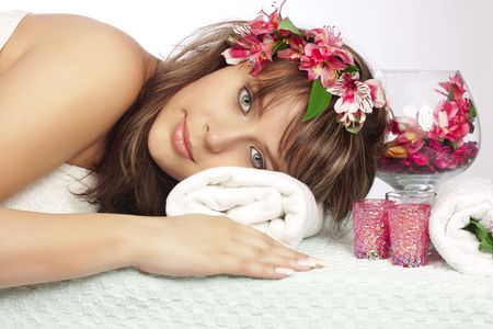 Beautiful woman on massage table with flower in hair Stock Photo - 6743464