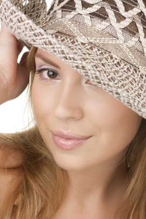 Portrait of a beautiful young woman in summer hat  photo