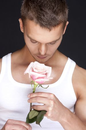 Young handsome men with the pink rose photo