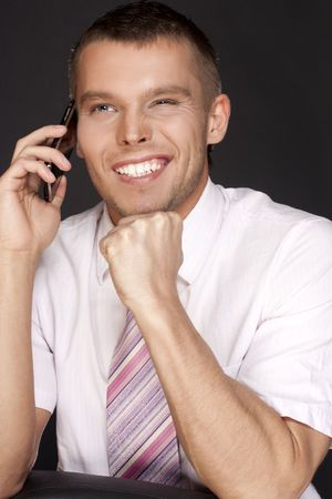 happy young businessman with a mobile phone photo