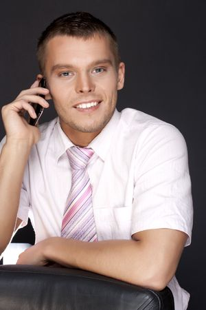 young businessman with a mobile phone photo