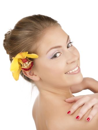 Portrait of a beautiful girl with a yellow orchid Stock Photo - 6809484