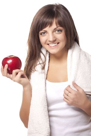 Beautiful young woman with red apple. Isolated over white  photo