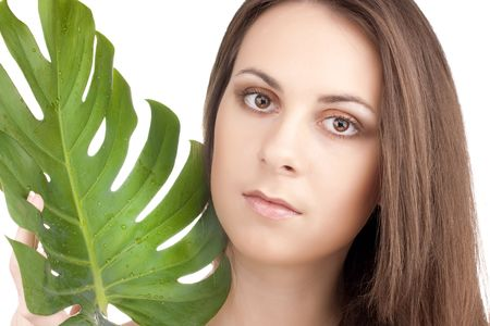 portrait of young beautiful girl with green leaf Stock Photo - 6813215