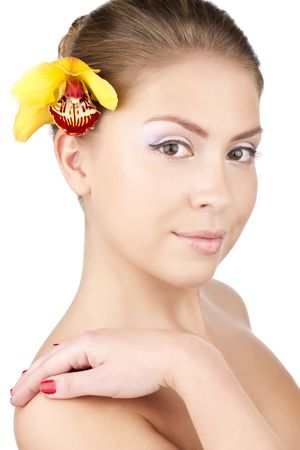 Portrait of a beautiful girl with a yellow orchid Stock Photo - 6813211