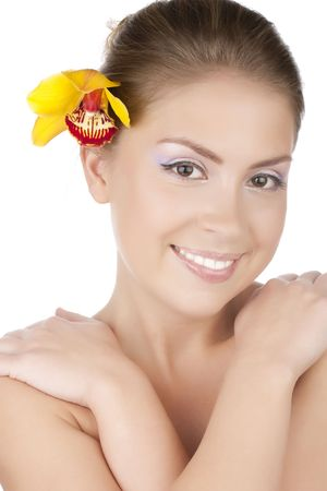 Portrait of a beautiful girl with a yellow orchid Stock Photo - 6813228