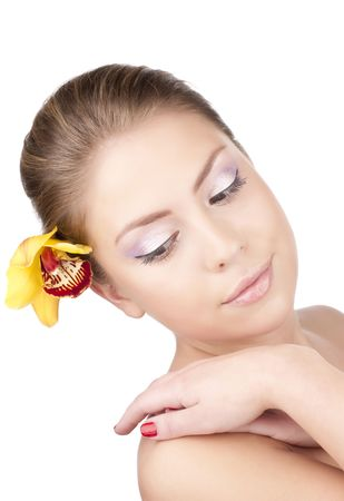 Portrait of a beautiful girl with a yellow orchid Stock Photo - 6813247