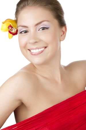 Portrait of a beautiful girl with a yellow orchid Stock Photo - 6813253