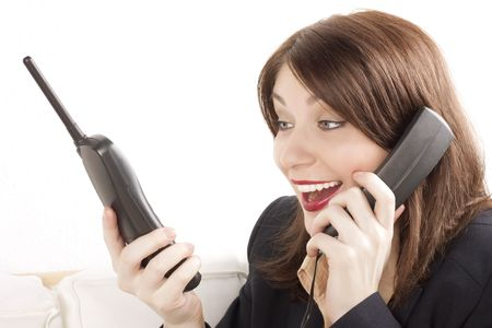 Beautiful businesswoman with two phones photo