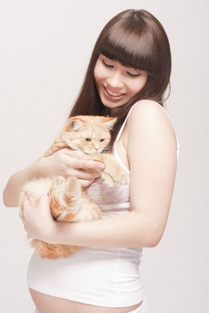 pregnant woman with cat photo