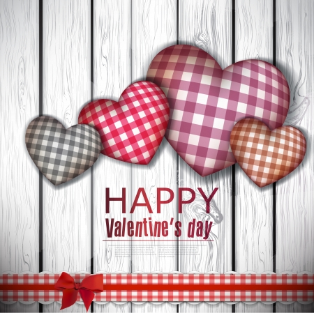Red cloth handmade hearts on wooden background. Valentines day.