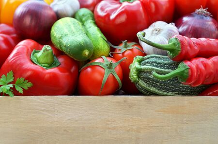 Harvest fresh vegetables in a wooden box with copy space below. The concept of healthy food. Reklamní fotografie