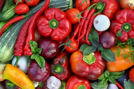 Various fresh vegetables as a background, top view. Healthy eating concept.