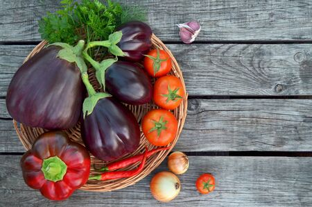 Fresh summer vegetables on a old wooden table. Close-up, top view