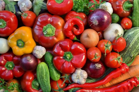 Various fresh vegetables as a background, top view. The concept of healthy food.