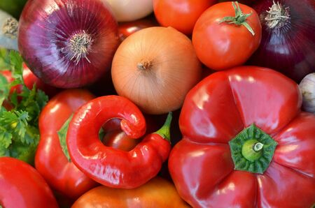 Various fresh vegetables close-up as a background, top view. The concept of healthy food.