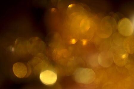 Shiny abstract background with festive defocused lights, golden bokeh. Christmas or New Year holiday concept. Banco de Imagens