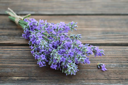 Fresh fragrant lavender flowers on a rustic wooden table. Close-up, selective focus