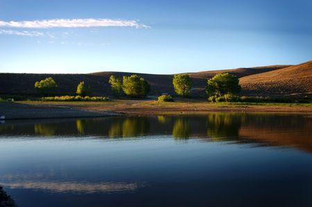topaz: Trees reflection on Lake Topaz Stock Photo