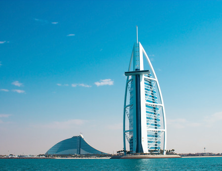 DUBAI, UAE - January, 2015: Two luxury hotels Burj Al Arab and Jumeirah Beach Hotel in Dubai. Back side of hotels, view from sea
