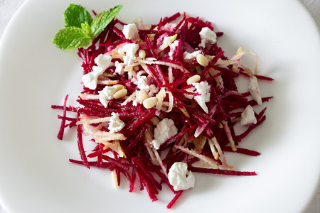 Beetroot salad with feta cheese, pears and nuts dressing sunflower oil. White background. Top view. Close up. Copy space. Toned photo Stock Photo