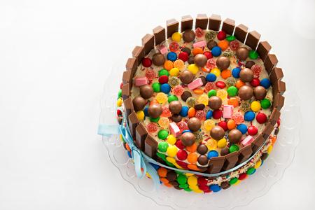 pinata: Pinata cake. Multicolored candies stuffed birthday cake with sweets inside. Stock Photo