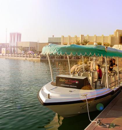 DUBAI, UAE - November, 17, 2017: Excursion pleasure of the boat at the Dubai Parks and Resorts. Dubai, United Arab Emirates. Toned photo. Selective photo.