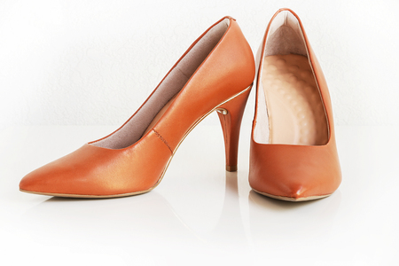 Pair of classic women brown leather heels. Fashion footwear. Isolated. White background.