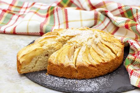Delicious homemade apple pie with cinnamon. Slate plate served. Selective focus. Standard-Bild
