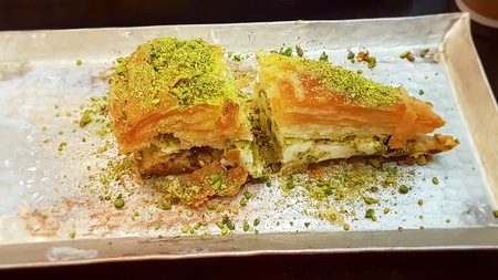 Turkish sweets baklava ice cream sandwich topped crushed pistachio. Selective focus.