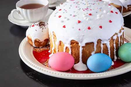 Easter cake and colorful eggs close-up. Happy Easter family breakfast concept. Selective focus.