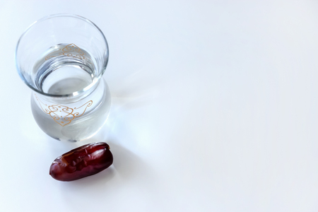 Organic dried dates and glass of water. Ramadan concept. Top view.