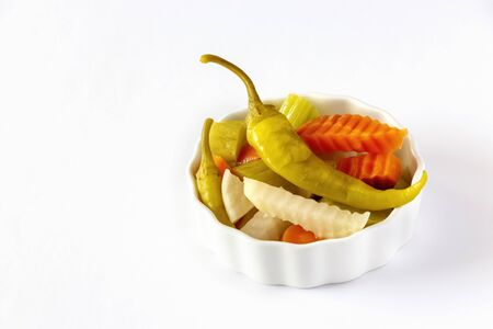 Assorted pickles vegetables carrot, chili, radish in white ceramic bowl. Top view. Isolated. Copy space. Stok Fotoğraf