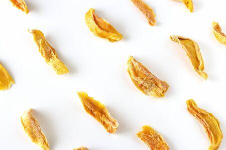 Sweet raw organic dried mango. White background. Isolated. Flatlay.