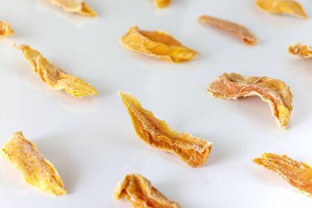 Sweet raw organic dried mango. White background. Isolated.