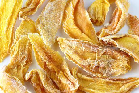 Sweet raw organic dried mango. Flatlay. White background. Isolated.