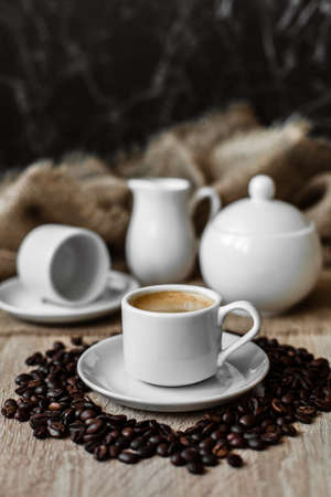 Espresso in a white cup, coffee beans, coffee
