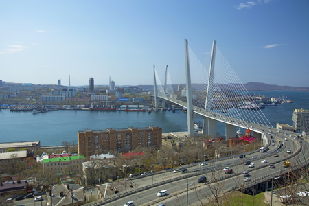 Marine City high bridge across the Bay, the sunny weather and beautiful Vladivostok Stock Photo