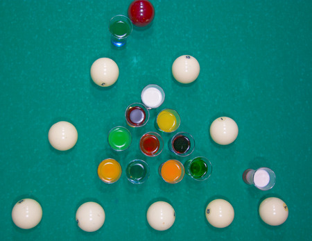 billiard: on a billiard table stand with coloured glasses of alcohol. Billiards, balls and stack