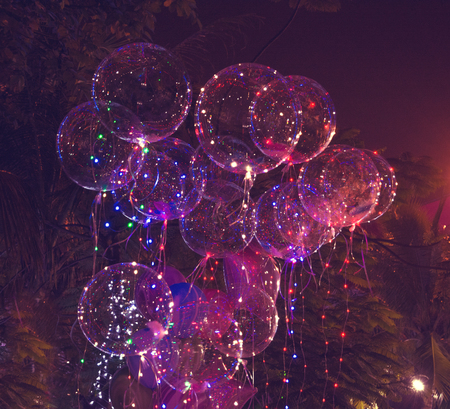 big beautiful gel balloons, painted lights and light bulbs. at night. Asia