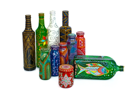 many different bottles, painted dot painted on isolated background. Creative painting. Stock Photo