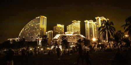 night city Sanya all lights, bright lights adorn the building. the tropics. Asia Stock Photo